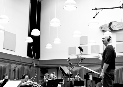 "Conducting the score he orchestrated for the TV series ""Olympus"""